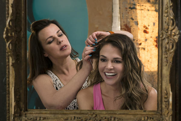 With the help of her friend Maggie (Debi Mazar), single mom Liza (Sutton Foster) recasts herself as a 26-year-old in order to get a coveted publishing job.