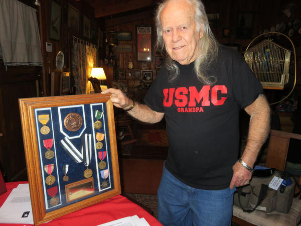 Pearl Harbor survivor Ed Johann displays a case of medals he earned during his Navy service from 1941-45.