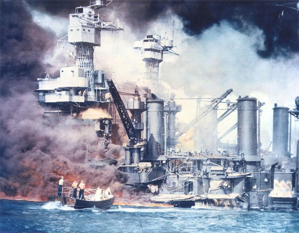 Thick smoke rolls out of a burning ship during the attack on Pearl Harbor on December 7, 1941.