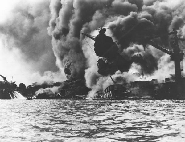 The USS Arizona on fire in Pearl Harbor. Johann's motor launch pulled alongside the sinking battleship to rescue casualties during the Pearl Harbor attack.