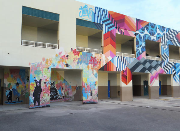 The walls at Eneida Hartner Elementary are now covered in art, including murals by Dutch artist duo Pipsqueak was here!!! and Holland-based David Junelouf.