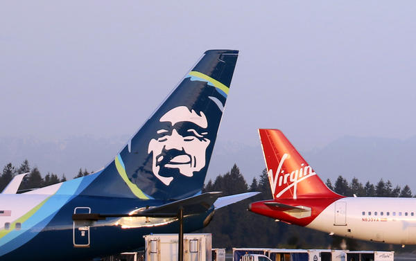 The U.S. Justice Department on Tuesday cleared the merger of Alaska Airlines and Virgin America on conditions.