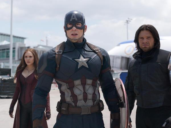Hawkeye/Clint Barton (Jeremy Renner), Scarlet Witch/Wanda Maximoff (Elizabeth Olsen), Captain America/Steve Rogers (Chris Evans), and Winter Soldier/Bucky Barnes in <em>Captain America: Civil War</em>
