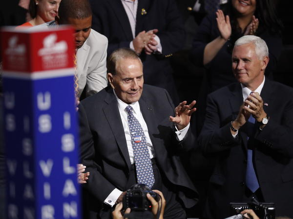 Sen. Robert Dole, seated next to then-vice presidential nominee Mike Pence, receives a standing ovation at the Republican National Convention in July.