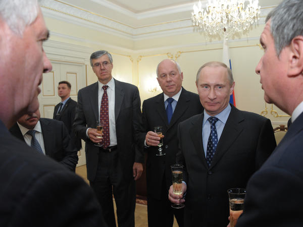 Vladimir Putin, then Russia's prime minister, toasts with ExxonMobil's Rex Tillerson (left foreground) and Igor Sechin (right foreground) outside Moscow in April 2012. Sechin, a close Putin ally, was then deputy prime minister and now serves as CEO of Russian oil giant Rosneft.
