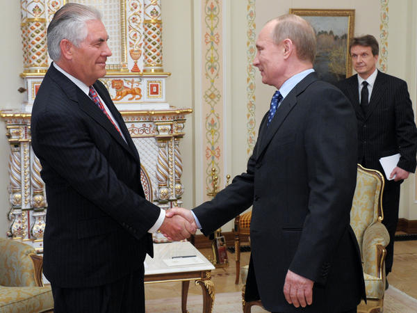 Vladimir Putin shakes hands with Rex Tillerson, chairman and chief executive officer of ExxonMobil Corp., at a meeting in April 2012, when Exxon teamed up with Russian oil giant Rosneft.