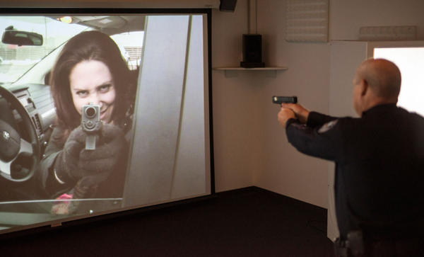 Pullman Police Chief Gary Jenkins tests WSU's new CBTsim, a deadly force decision-making training program commercialized from university research on police behavior.