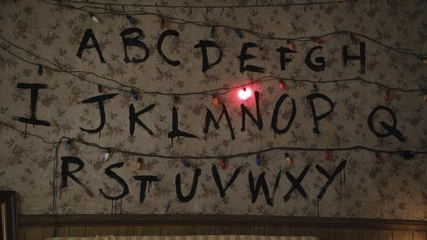 N Is For 'Nona: In the Netflix series <em>Stranger Things</em>, Joyce (Winona Ryder) uses Christmas lights to communicate with her missing son.