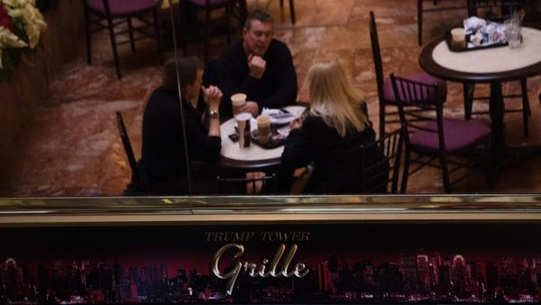 Patrons are reflected in a mirror as they eat at Trump Tower Grille at Trump Tower in New York. A critical <em>Vanity Fair</em> review preceded criticism of the magazine by the president-elect on Twitter.