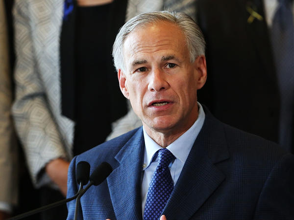 Texas Gov. Greg Abbott at Dallas' City Hall in July. Abbott has strongly endorsed new rules that would require removed fetal tissue to be buried or cremated.