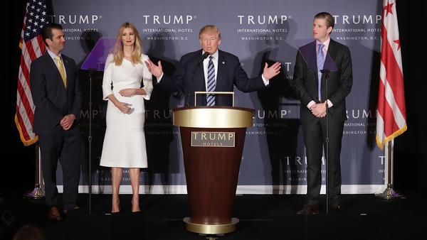Donald Trump with his eldest children at the grand opening of the Trump International Hotel in Washington, D.C. Trump says he'll turn over control of his businesses to sons Eric and Donald Jr.