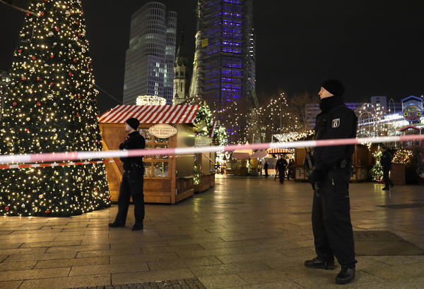 Police survey the area after someone rammed a truck into a crowded Christmas market in Berlin on Monday.