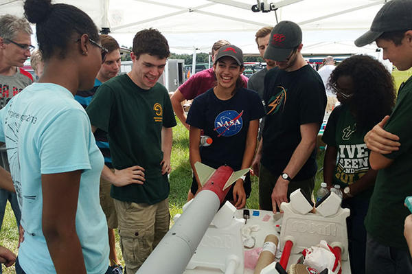 USF sophomore Brooke Salas (center in NASA shirt) jokes with other SOAR members.