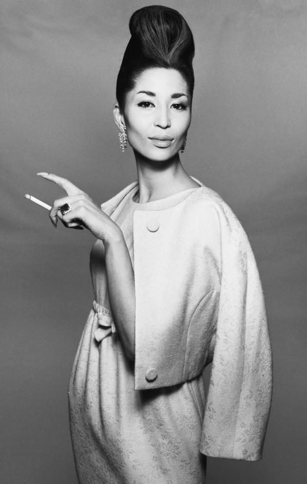 Model China Machado in a dinner dress and jacket by Ben Zuckerman, New York, in November 1958.