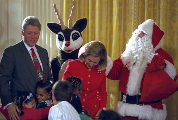 President Clinton with then first lady Hillary Clinton, Santa and Rudolph the Red Nosed Reindeer on Dec. 22, 1994.