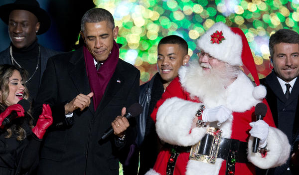 President Obama dances onstage with Santa and members of Fifth Harmony during the National Christmas Tree Lighting in 2014.