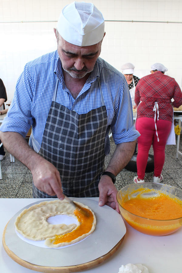 After molding marzipan into the traditional shape of <em>anguila</em>, or eel, Santiago Manzanero fills it with <em>yema</em>, egg yolk mixed with sugar. It's then baked in the same kind of wood-fired oven his great-grandfather used, and decorated by candied fruit and a piped icing of egg whites and sugar arranged on top in elaborate drawings.