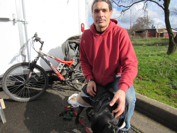 Michael LaConte, with his companion Khaleesi. LaConte and Khaleesi will be among the first to occupy one of the tiny houses at Hope Village in Medford.