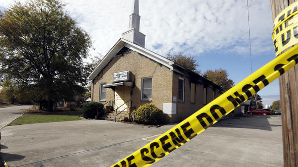 Crime scene tape outlines the perimeter of the Hopewell Missionary Baptist Church in Greenville, Miss., on Nov. 22. A member of the church has been arrested and charged with arson for the Nov. 1 burning of the building, the Associated Press reports.