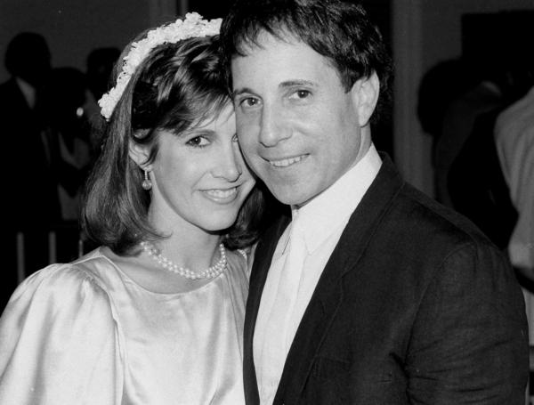 Carrie Fisher and singer-composer Paul Simon stand together at their apartment in New York during their wedding reception in 1983.