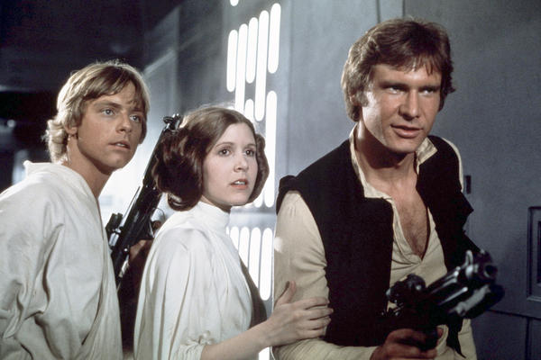 (From left) Actors Mark Hamill, Carrie Fisher and Harrison Ford on the set of<em> Star Wars: Episode IV — A New Hope</em>.