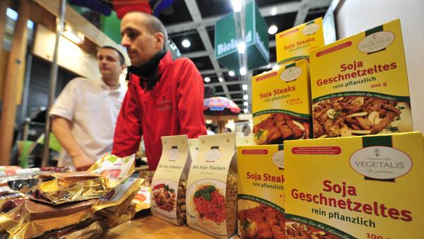 "Fair workers at a vegetarian stand sell meatless items at the ""Bio"" (organic food) section of the International Green Week Food and Agriculture Fair in Berlin in 2011. Germany's minister of agriculture has called for a ban on using meaty words like ""schnitzel"" and ""würst"" to market such products."