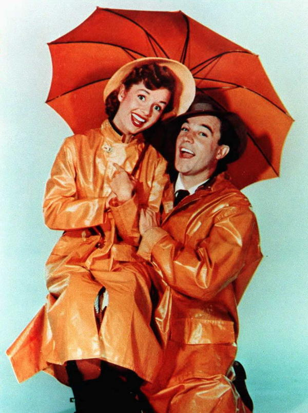 Gene Kelly and Debbie Reynolds from the movie <em>Singin' in the Rain</em>.