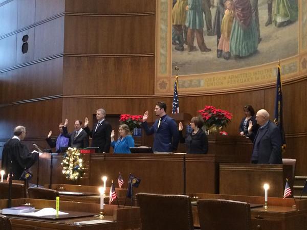 The seven Oregon electors take the oath of office in the Oregon Senate chambers.