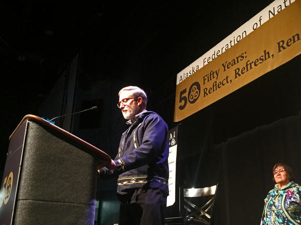 The Presbyterian Church's Curt Karns read an apology before hundreds gathered for the Alaska Federation of Natives Convention in Fairbanks, Alaska.