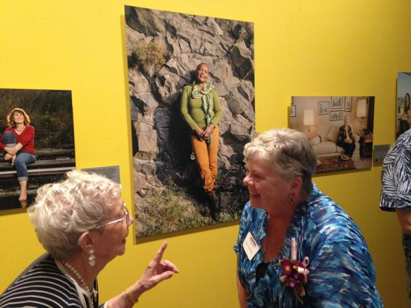 Top-secret World War II secretary Sue Olson chats with nuclear cleanup advisor Susan Leckband under the portrait gaze of geologist Zelma Maine Jackson. All three women were interviewed and photographed for the history project Daughters of Hanford.