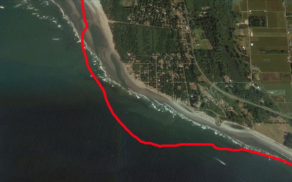 Satellite view of Washaway Beach in 2011. The red line marks the shoreline in 1990.