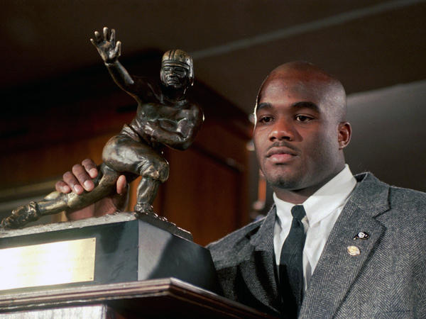 A Colorado coroner says that former Heisman winner, Rashaan Salaam (pictured in 1994), died of a self-inflicted gunshot wound. Salaam's body was found at a Boulder park on Dec. 5 this year.