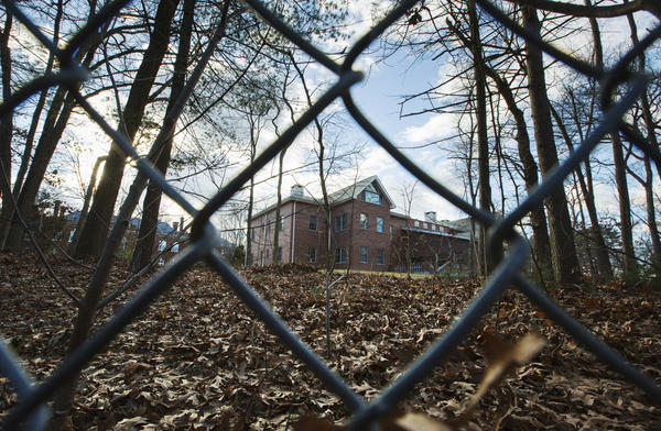A fence surrounds an estate in the village of Upper Brookville in the town of Oyster Bay, N.Y., on Long Island. On Friday, the Obama administration closed this compound for Russian diplomats, in retaliation for spying and cyber-meddling in the U.S. presidential election.