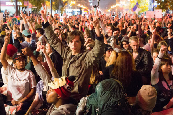 <p>Protesters in Portland sat in a moment of silence honoring Michael Brown, an unarmed black man shot by police in Ferguson, Missouri.</p>