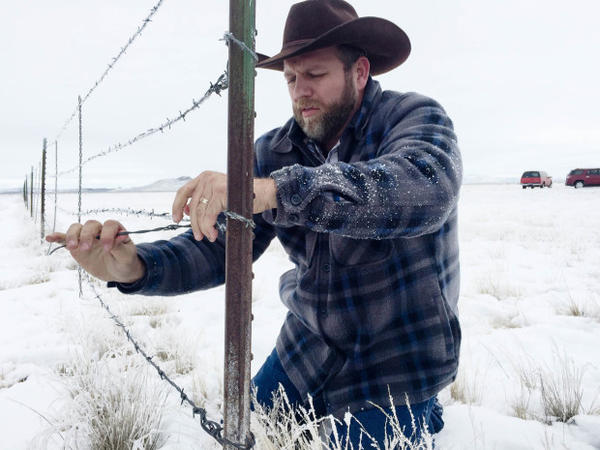 <p>Ammon Bundy removes a fence separating the Malheur National Wildlife Refuge from ranching land.</p>