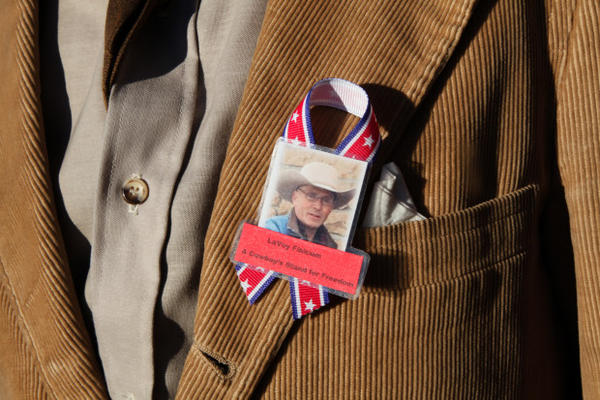 <p>Mourners wore ribbons, and some pinned squares cut from a blue tarp to their coats, a reference to a nickname some gave Finicum during the occupation of the Malheur National Wildlife Refuge.</p>