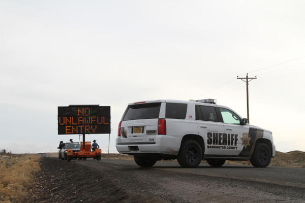 <p>A Washington County Sheriff's vehicle blocks the road leading to the Malheur National Wildlife Refuge. The 41-day armed occupation of the refuge ended Thursday, Feb. 11.</p>