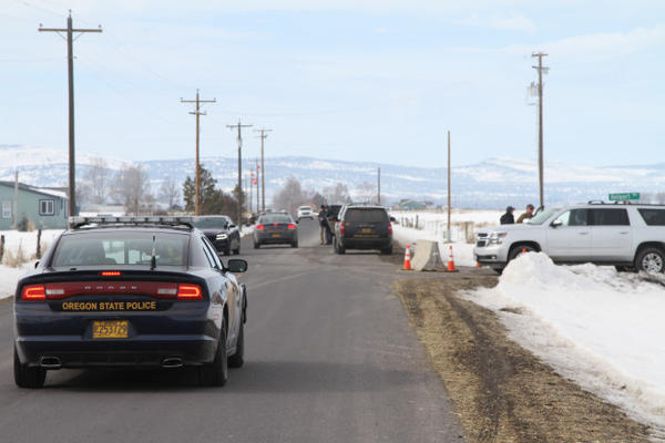 <p>Law enforcement vehicles leave the Burns airport. The armed occupation of the Malheur National Wildlife Refuge ended Thursday, Feb. 11.</p>