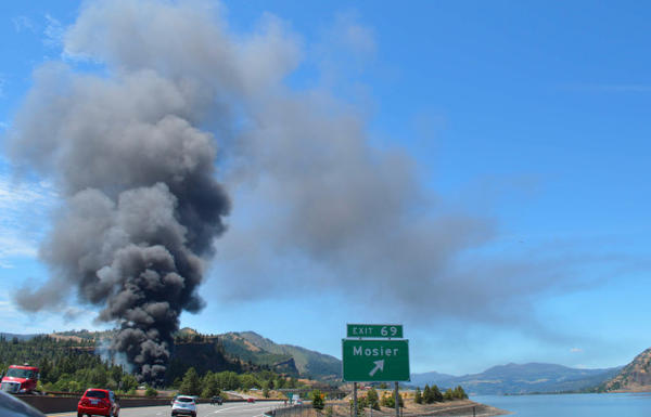 <p>A plume of smoke rises from where a train carrying crude oil derailed in Mosier, near Hood River, on Friday afternoon.</p>