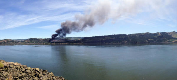 <p>Smoke rises from the train derailment near Mosier, Oregon, as seen from Washington state Route 14 between Bingen and Lyle.</p>