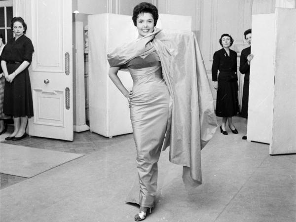 Lena Horne, the sultry American singer who appeared in several musicals in the '40s and was a regular of the Cotton Club, trying on a dress May 4, 1956.