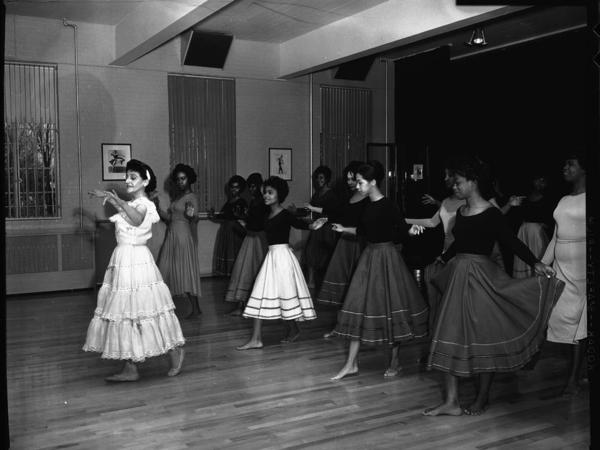 Argentine dancer instructing a group of young women behind her in a dance at Howard University in February 1963.