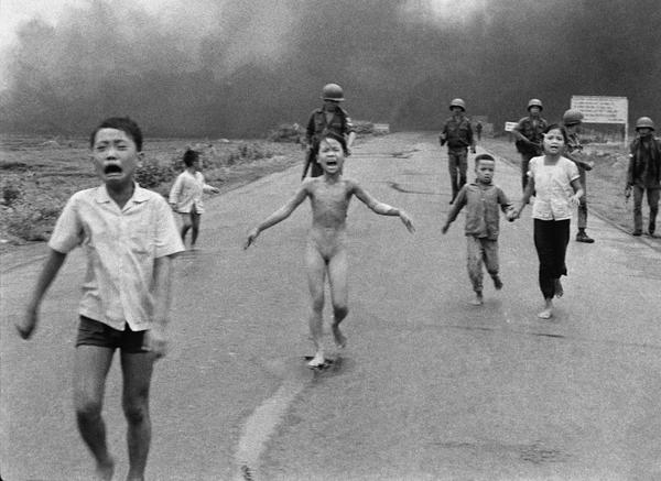 Severely burned in an aerial napalm attack, children run screaming for help down Route 1 near Trang Bang, followed by soldiers of the South Vietnamese army's 25th Division, June 8, 1972. A South Vietnamese plane seeking Viet Cong hiding places accidentally dropped its flaming napalm on civilians and government troops instead. Nine-year-old Kim Phuc (center) had ripped off her burning clothes while fleeing. The other children (from left) are her brothers Phan Thanh Tam, who lost an eye, and Phan Thanh Phouc, and her cousins Ho Van Bon and Ho Thi Ting. (Nick Ut/AP) 1973 Pulitzer Prize winner for Spot News Photography