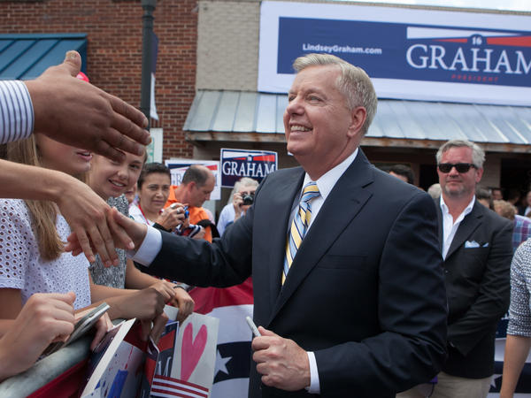 U.S. Sen. Lindsey Graham, R-SC, shakes hands with supporters after announcing his candidacy for United States President during an outdoor event on June 1, 2015 in Central, South Carolina.