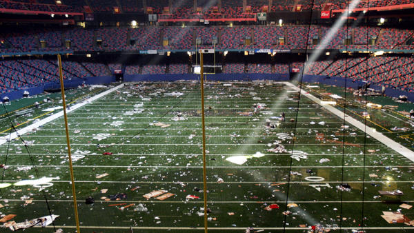 Huge shafts of light strike the littered playing field of the Louisiana Superdome in New Orleans on Sept. 2, 2005, four days after Hurricane Katrina. The Superdome was a squalid shelter to tens of thousands of residents for days after the storm, including the Halley sisters and their mother.
