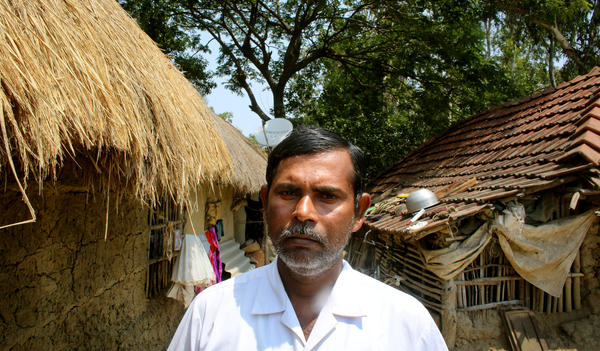 Rubil Saha has lived on Ghoramara his whole life. Saha's parents and other relatives have all left. The 45-year-old farmer worries about continually having to rebuild his house, but he chooses to stay on the island.