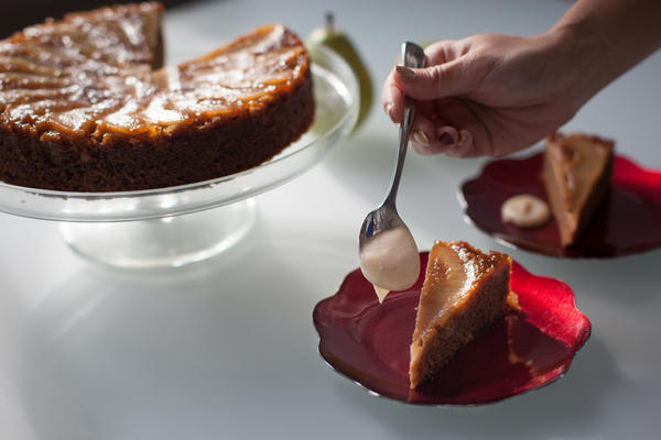 Aggie Chin adds lightly whipped cream to her pear cake.