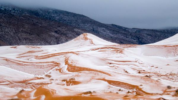 Snow fell in and around the town of Ain Sefra, Algeria, on Monday.