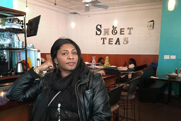 Untold RVA's tour guide, historian Free Egunfemi, sits inside Sweet Tea's Southern Cuisine, a restaurant with a history in the Underground Railroad.