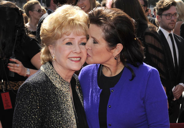 Debbie Reynolds and her daughter, Carrie Fisher, at the Primetime Creative Arts Emmy Awards in 2011 in Los Angeles. Reynolds' death, just one day after her daughter's, has led many to ask whether it's really possible to die of a broken heart.